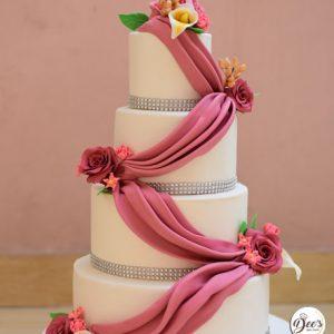 Drapes And Flowers Wedding Cake